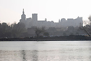 Pope's Palace in Avignon and the Rhone river in morning mist at sunrise, Vaucluse, Rhone, Provence, France