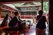 JAPAN, NIKKO - August 2012 - Toshogu Shrine is where the famous Shogun of the Edo Period in the 17th century, Tokugawa Ieyasu, was worshiped after his death. It became as luxurious and elaborate as it looks today when the grandson of Ieyasu, the third Shogun Tokugawa Iemitsu, reconstructed it. The engravings on the Yomei-mon Gate are especially overwhelming, provided with every luxury imaginable and redolent in gorgeous colors. site calssified as Japanese Cultural property and world heritage by UNESCO [FR] Sanctuaire Toshogu - Construit en 1636 à la mémoire de Ieyasu, fondateur du shogunat Tokugawa. Contrairement aux autres sanctuaires shinto, caractérisés par une architecture épurée se fondant dans le paysage environnant, ce sanctuaire est une exubérance de couleurs, d'applications de feuilles d'or et de sculptures en tous genres.Site classé propriete culturelle du Japon et patrimoine mondial de l'UNESCO