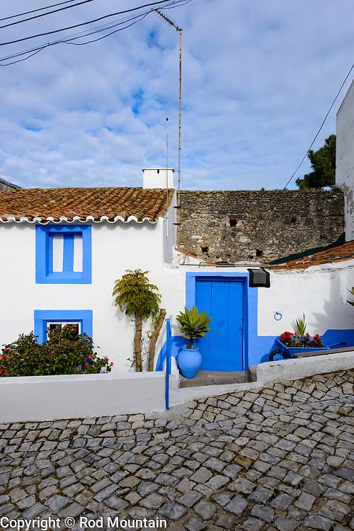 A humble abode not far from a popular lookout area overseeing Nazare and beach.<br />  <br /> https://en.wikipedia.org/wiki/Nazaré,_Portugal<br /> https://www.visitportugal.com/en/node/73770<br /> <br /> Image: © Rod Mountain<br /> www.rodmountain.com<br /> <br /> #tourismportugal #portugal #visitportugal #portugal🇵🇹 #culturaportugesa <br /> #traveldeeper<br /> #suitcasetravels<br /> #letsgosomewhere<br /> #welltravelled<br /> #travelmemories<br /> <br /> #turismoemportugal #turismo #stayandwander <br /> #wonderlust.portugal #paperjournalmag #foammagazine #rentalmag #documentyourdays<br /> <br /> #Nazare #HomeSweetHome <br /> <br /> @visitportugal