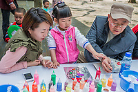 Shanghai, China - April 7, 2013: three generation family sketching leisure in fuxing park at the city of Shanghai in China on april 7th, 2013