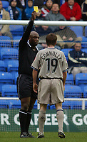 Photo: Daniel Hambury.<br /> Reading v Leicester City. <br /> The Coca Cola Championship.<br /> 26/02/2005<br /> Leicester's David Connolly is booked by referee Uriah Rennie.