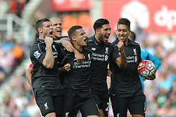 Philippe Coutinho of Liverpool celebrates with his team mates after scoring - Mandatory byline: Dougie Allward/JMP - 07966386802 - 09/08/2015 - FOOTBALL - Britannia Stadium -Stoke-On-Trent,England - Stoke City v Liverpool - Barclays Premier League