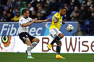 Brentfords' Andre Gray shields the ball from Bolton Wanderers' Jay Spearing. Skybet football league championship match, Bolton Wanderers v Brentford at the Macron stadium in Bolton, Lancs on Saturday 25th October 2014.<br /> pic by Chris Stading, Andrew Orchard sports photography.