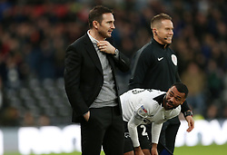 Derby County manager Frank Lampard gets ready to send on Derby County's Ashley Cole during the match at Pride Park