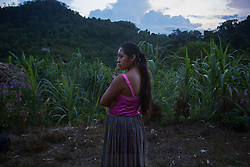 """Portrait of Carmen, 14, who is 3 months pregnant, """"I was in school until 5th grade, when I got married.  I have been raising my chickens to kill them when the baby is born."""""""
