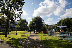 London, UK. 14th August, 2021. A children's playground and communal space at Bells Gardens in Peckham. Southwark Council proposes to build 97 new homes (a mix of social and private housing), a reprovisioned community facility and a multi-use games area at Bells Gardens, a well-used community park serving the 545-home Bells Gardens estate. Southwark ranks fifth-worst in London and eighth-worst in the UK for easy access to green space.