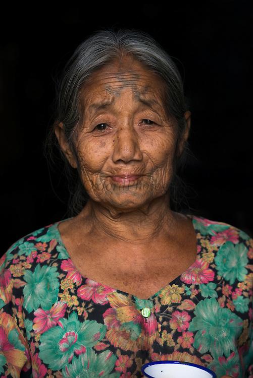 Ao Naga woman with facial tattoos<br /> Ao Naga headhunting Tribe<br /> Mokokchung district<br /> Nagaland,  ne India