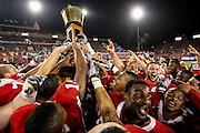 Oct 27, 2011; Houston, TX, USA; The Houston Cougars celebrate defeating the Rice Owls 73-34 with the Bayou Bucket  at Robertson Stadium. Mandatory Credit: Thomas Campbell