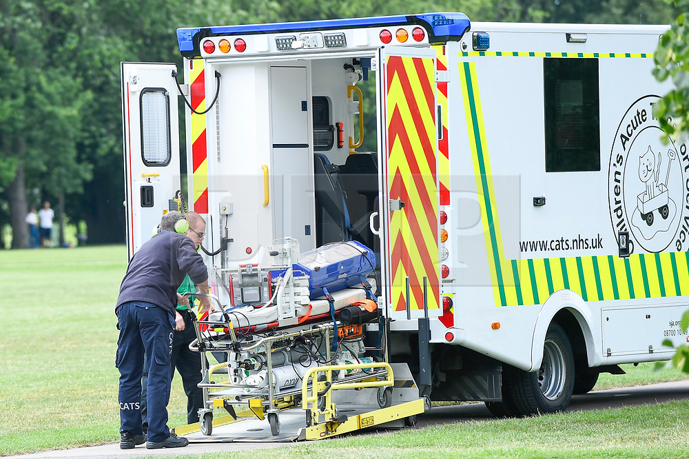 © Licensed to London News Pictures. 03/07/2019. LONDON, UK.  Medical equipment is removed from a Children's Acute Transport Service (CATS) ambulance on behalf of nearby Great Ormond Street Hospital to be transferred to a Coastguard Rescue helicopter which is waiting to take off from Regent's Park.  The helicopter will make the journey to collect a sick child who will be brought back for treatment at Great Ormond Street as travel by road would take too long.  Photo credit: Stephen Chung/LNP
