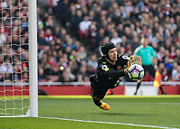 Football - 2016 / 2017 Premier League - Arsenal vs. Manchester United<br /> <br /> Petr Cech of Arsenal dives to his right to push away the attempt on goal from Wayne Rooney of Manchester United at The Emirates.<br /> <br /> COLORSPORT/DANIEL BEARHAM