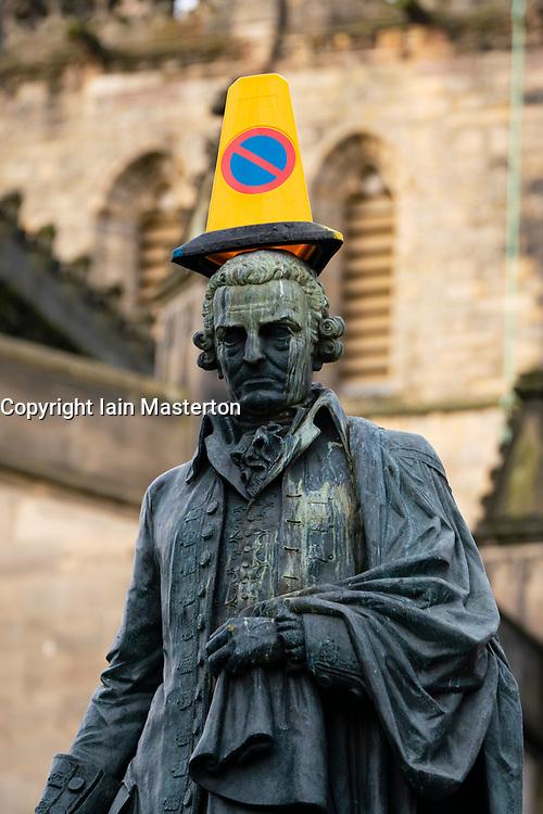 Edinburgh, Scotland, UK. 18 March 2020.Traffic cone placed on statue of Adam Smith on the Royal Mile in Edinburgh. Iain Masterton/Alamy Live News.