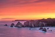 Dawn on a rocky coast with ridges in the sea, Asturias, Spain<br /> <br /> Morgenrot an einer Felsküste mit Felszacken im Meer, Asturien, Spanien