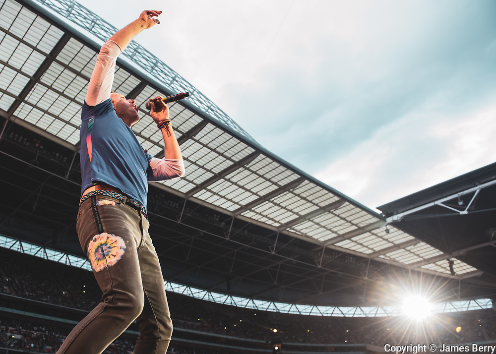 Coldplay perform live at the second of a four-night residency at Wembley Stadium, London on Tuesday 16 June 2016. Picture shows Chris Martin.
