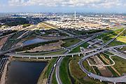 Nederland, Zuid-Holland, Rotterdam, 09-05-2013; Hoogvliet, knooppunt Benelux (Beneluxplein). Werkzaamheden ter voorbereiding van het verbreden van rijksweg A15 richting Maasvlakte (diagonaal naar linksboven)..Overview of the road widening of motorway A15 at the Junction (Knooppunt) Beneluxplein, in Rotterdam, in western direction, river Nieuwe Maas in the back. Port of Rotterdam, oil storage (l)..luchtfoto (toeslag op standard tarieven).aerial photo (additional fee required).copyright foto/photo Siebe Swart