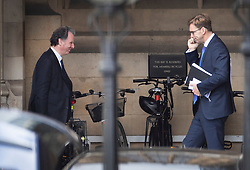 © Licensed to London News Pictures. 03/04/2019. London, UK. Conservative MPs Oliver letwin (L) and Tobias Ellwood are seen at Parliament.  Labour Party Leader Jeremy Corbyn is holding talks with Prime Minister Theresa May to seek a way forward with the Brexit deadlock. Photo credit: Peter Macdiarmid/LNP