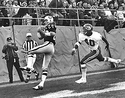 Oakland Raider Fred Biletnikoff grabs TD pass in front of Kansas City defender Jim Marsalis. <br /> (photo by Ron Riesterer)