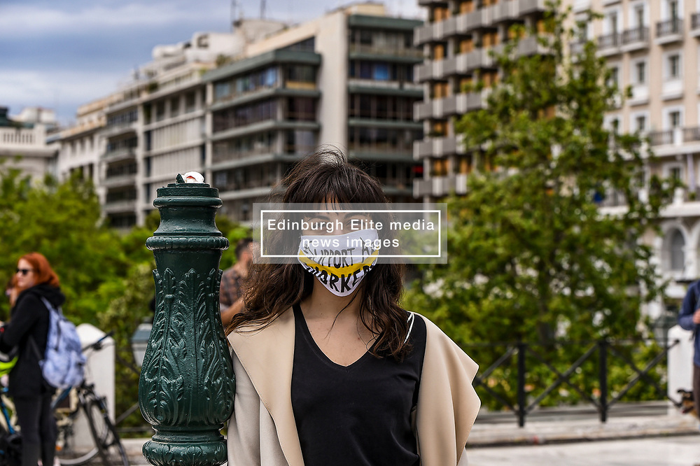 """A woman wears a protective facemask reading the message """"support artists"""" as she takes part in a demonstration, in Syntagma Square, in front of the Greek parliament in central Athens, on May 7, 2020 during a rally organised by artists, musicians and actors to ask for help to the Greek government for the financial loses due to the lockdown aimed at curbing the spread of the COVID-19<br /> <br /> Pictured: <br /> Dimitris Lampropoulos  
