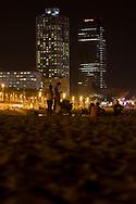 Young people enjoying the evening at Barceloneta Beach, Barcelona, Spain 2017.