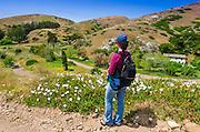 Hiker on Scorpion Canyon Loop Trail above Scorion Ranch, Santa Cruz Island, Channel Islands National Park, California USA