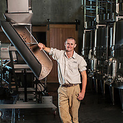 Joshua Grainer, Technical Director of RdV Vineyards, poses for a portrait in the winery.