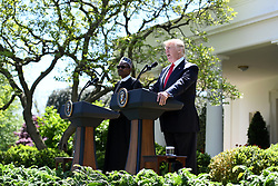 US President Donald Trump and Nigerian President Muhammadu Buhari speak at a joint press conference in the Rose Garden of the White House on April 30, 2018 in Washington, DC. Photo by Olivier Douliery/Abaca Press