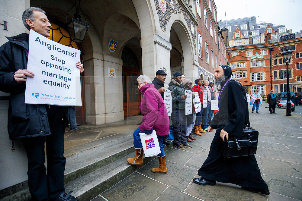 © Licensed to London News Pictures. 15/02/2017. London, UK. Church members walk in whilst LGBT Campaigners, including Peter Tatchall, hold a protest vigil outside the General Synod of the Church of England, where same sex marriage is due to be debated. Photo credit: Tolga Akmen/LNP