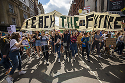May 24, 2019 - London, England, United Kingdom - Students are seen holding up a banner which reads 'Teach The Future' during a demonstration in London. Students continue to stage protests, urging the government to declare a climate emergency and take action over the problem. They are keen that the national curriculum is reformed and the environmental crisis is communicated to the public. (Credit Image: © Vernon Yuen/NurPhoto via ZUMA Press)