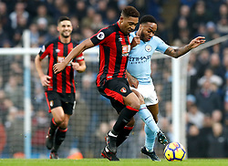 AFC Bournemouth's Jordon Ibe and Manchester City's Raheem Sterling battle for the ball during the Premier League match at the Etihad Stadium, Manchester.