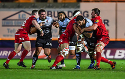 Toulon's Romain Taofifenua is tackled by Scarlets' David Bulbring and Aaron Shingler<br /> <br /> Photographer Craig Thomas/Replay Images<br /> <br /> European Rugby Champions Cup Round 5 - Scarlets v Toulon - Saturday 20th January 2018 - Parc Y Scarlets - Llanelli<br /> <br /> World Copyright © Replay Images . All rights reserved. info@replayimages.co.uk - http://replayimages.co.uk