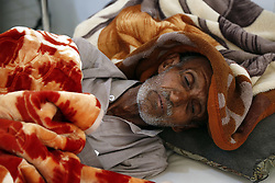 March 28, 2019 - Sanaa, Yemen - An elderly man lies in bed and receives medical treatment at a hospital in Sanaa, Yemen. More than 11,000 suspected cases of cholera have been treated in Yemen since the start of this year at 11 health facilities across the war-torn country, the International Committee of the Red Cross (ICRC) Office in capital Sanaa said in a recent statement. (Credit Image: © Mohammed Mohammed/Xinhua via ZUMA Wire)