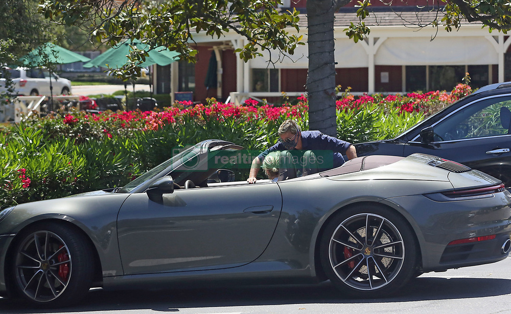 """EXCLUSIVE: Ellen DeGeneres and Portia DeRossi who have been staying inside their fancy home in Santa Barbara, take a break from being cooped up what Ellen described as, her """"prison"""" and head out in their convertible Porsche. Ellen has come under fire in recent weeks, first for describing her home as being like a """"prison"""" which made her seem out of touch, to fans. And then more recently comedian, Kevin T. Porter crowdsourced """"insane stories you've heard about Ellen being mean"""" in exchange for $2 donations to the Los Angeles Regional Food Bank — and received thousands of responses. Amidst all this public hostility, the 62 year-old comedian and her 47 year-old wife are spotted enjoying a bit of a wander around Santa Barbara on Memorial Day while wearing masks to guard against possible spreading coronavirus. At one point Portia stopped by Wendy Foster and showed Ellen, who was drinking an iced-tea, a dress she like while draping it across her body, much to the amusement of a pair of (unmasked) onlookers. 23 May 2020 Pictured: Ellen DeGeneres, Portia DeRossi. Photo credit: Rachpoot/P&P/MEGA TheMegaAgency.com +1 888 505 6342"""
