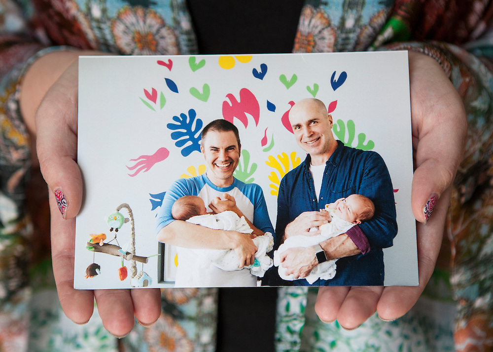 Claire Nielsen holds a photo of the twins she carried, held in the photo by their parents, at her home in Maple Grove June 9, 2015. Claire carried twins as a gestational surrogate for a California couple and gave birth to them in December of 2014.  (Courtney Perry/Special to the Star Tribune)