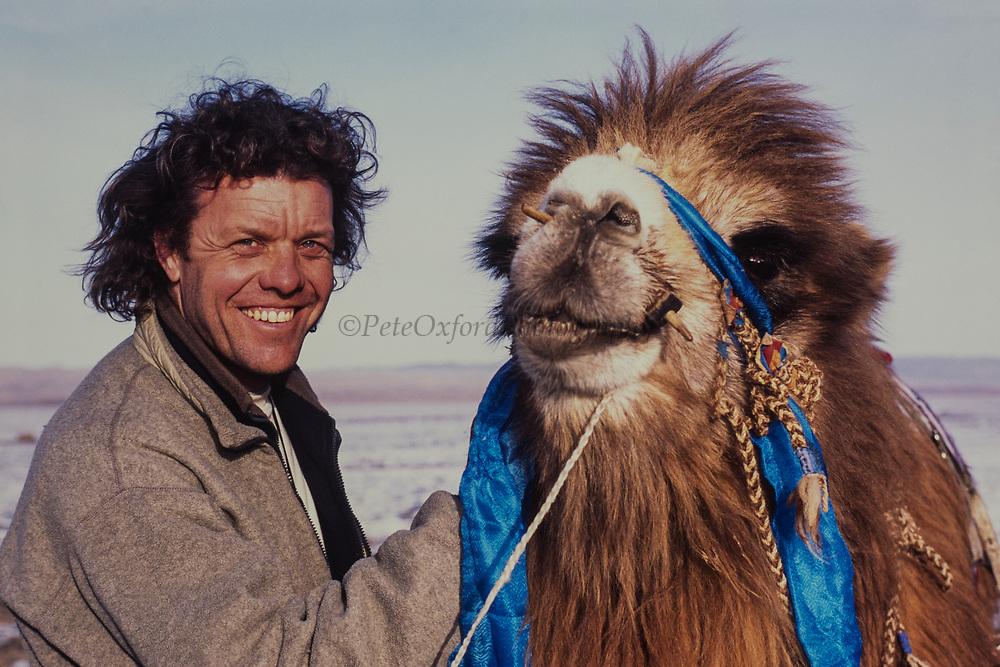 Bactrian camel (Camels bactrians) & Pete Oxford<br /> Southern Gobi Desert<br /> Mongolia<br /> winter
