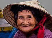 Woman boat operator in Hoi an.
