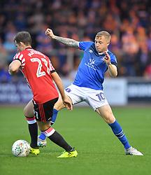 Carlisle United's Nicky Adams tries to stop Sunderland's Adam Matthews