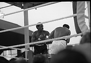 Ali vs Lewis Fight, Croke Park,Dublin.<br /> 1972.<br /> 19.07.1972.<br /> 07.19.1972.<br /> 19th July 1972.<br /> As part of his built up for a World Championship attempt against the current champion, 'Smokin' Joe Frazier,Muhammad Ali fought Al 'Blue' Lewis at Croke Park,Dublin,Ireland. Muhammad Ali won the fight with a TKO when the fight was stopped in the eleventh round.<br /> .<br /> This picture shows Lewis preparing to throw a right into Ali's head.