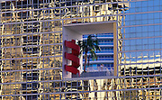 Image of high rise buildings in Miami, Florida with palm trees and window reflections, American Southeast by Randy Wells