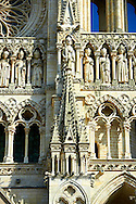 Gothic  statues and the facade of the Gothic Cathedral of Notre-Dame, Amiens, France . The Cathedral Basilica of Our Lady of Amiens or simply Amiens Cathedral, is a Roman Catholic  cathedral the seat of the Bishop of Amiens. It is situated on a slight ridge overlooking the River Somme in Amiens. Amiens Cathedral, was built almost entirely between 1220 and c.1270, a remarkably short period of time for a Gothic cathedral, giving it an unusual unity of style. Amiens is a classic example of the High Gothic style of Gothic architecture. It also has some features of the later Rayonnant style in the enlarged high windows of the choir, added in the mid-1250s. Amiens Cathedra has been listed as a UNESCO World Heritage Site since 1981. Photos can be downloaded as Royalty Free photos or bought as photo art prints. <br /> <br /> Visit our MEDIEVAL PHOTO COLLECTIONS for more   photos  to download or buy as prints https://funkystock.photoshelter.com/gallery-collection/Medieval-Middle-Ages-Historic-Places-Arcaeological-Sites-Pictures-Images-of/C0000B5ZA54_WD0s