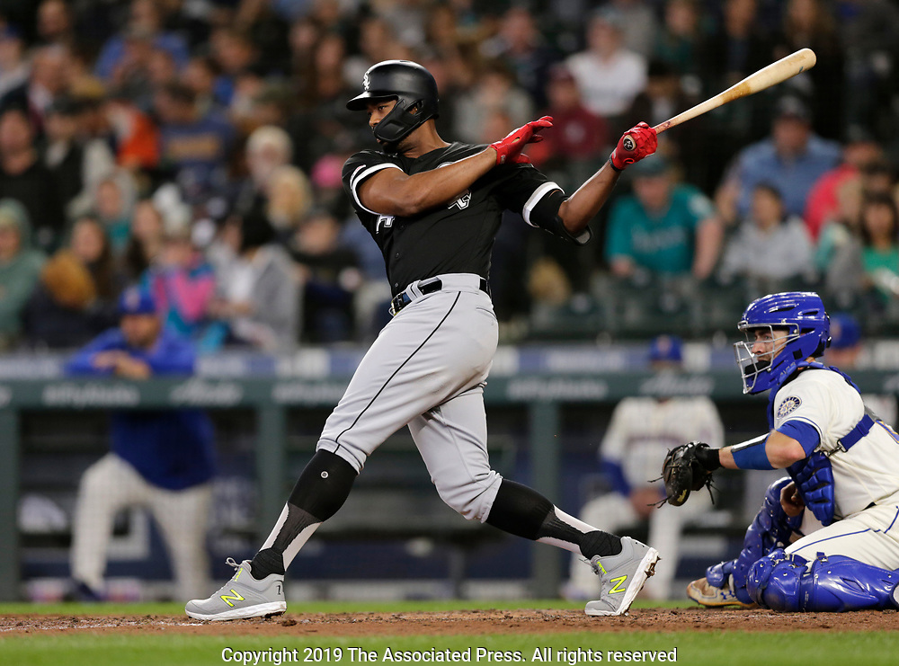 Chicago White Sox's Jose Abreu hits an RBI single against the Seattle Mariners during the fifth inning of a baseball game, Sunday, Sept. 15, 2019, in Seattle. (AP Photo/John Froschauer)