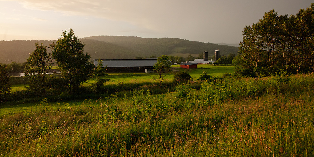 A summer rainstorm rolling through the hilly farmlands of Vermont.
