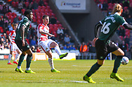 Tommy Rowe of Doncaster Rovers (10) passes the ball during the EFL Sky Bet League 1 match between Doncaster Rovers and Plymouth Argyle at the Keepmoat Stadium, Doncaster, England on 13 April 2019.