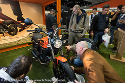 The very popular Ducati Scrambler on display in the Ducati booth at EICMA, the largest international motorcycle exhibition in the world. Milan, Italy. November 19, 2015.  Photography ©2015 Michael Lichter.