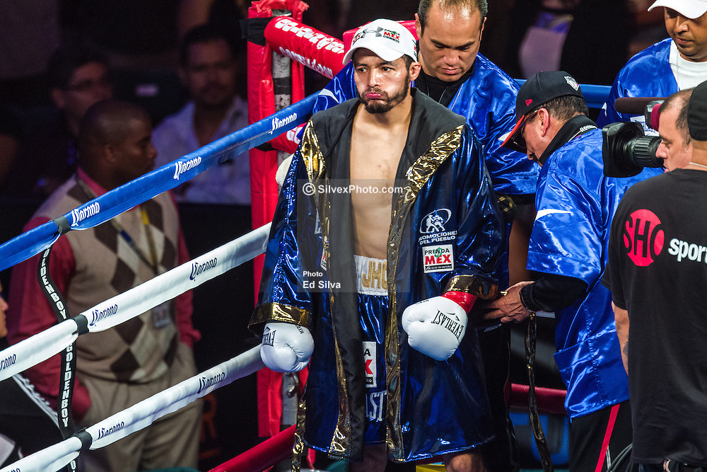 CARSON, California/USA (Saturday, Aug 24 2013) -  Jhonny Gonzales arrives at the ring for the Mares vs Gonzalez bout. Mexican pro boxer Jhonny Gonzalez (55-8, 47 KOs) claimed the WBC Featherweight belt by TKO in the first round during his fight with Abner Mares (27-1-1, 14 KO's) at the StubHub Center (formerly Home Depot Center) in Carson, California USA. Jhonny (blue trunks) sent Abner Mares (black truncks) twice to the canvas in the first round. The main referee stopped the bout after the second knockdown at 2 minutes 55 seconds into the first  round. This is Abner first loss in his pro boxing career. August 24, 2013 in Carson, California. PHOTO © Eduardo E. Silva/SILVEXPHOTO.COM.