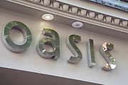 Sign for the high street clothing brand Oasis in Birmingham, United Kingdom.