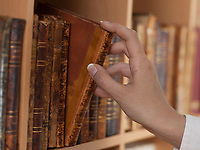 woman hand holding old book library close up