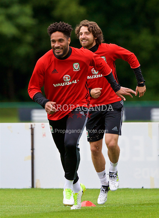 CARDIFF, WALES - Thursday, June 8, 2017: Wales' captain Ashley Williams and Joe Allen during a training session at the Vale Resort ahead of the 2018 FIFA World Cup Qualifying Group D match against Serbia. (Pic by David Rawcliffe/Propaganda)
