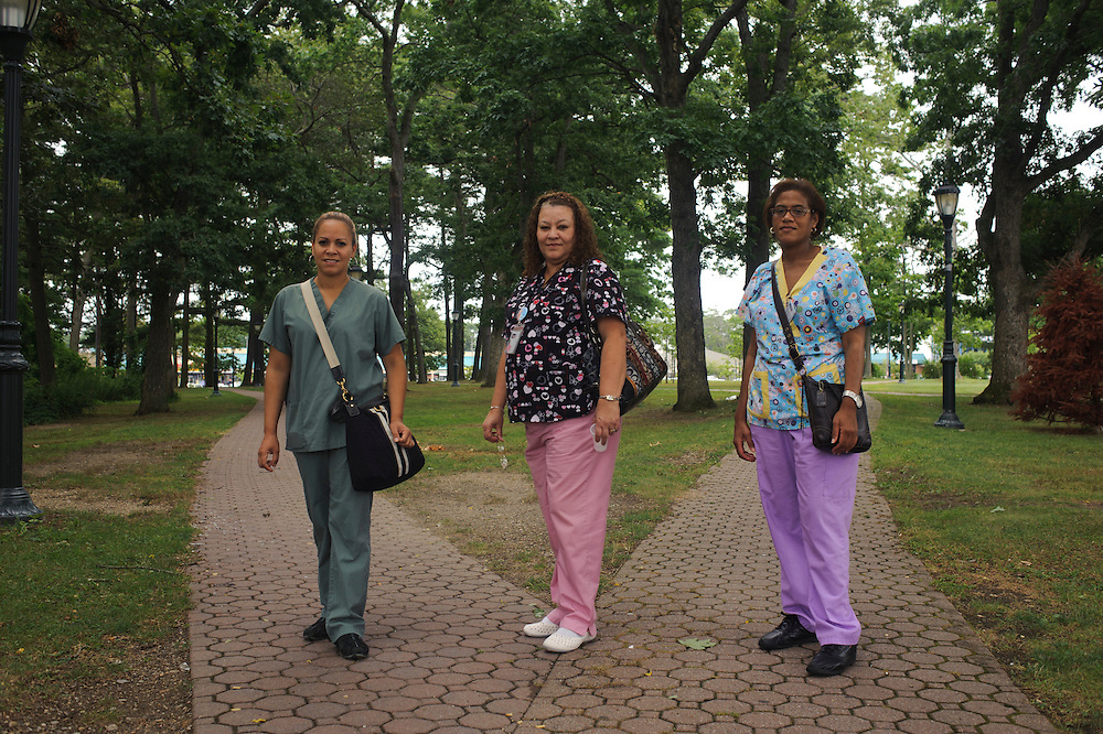 Kenia Escobar from Dominican Republic, Claribel Marcano from Puerto Rico and Migdalia Vazquez from Puerto Rico pose for a photograph in their lunch break from their work at the Brentwood Health Center. (July. 19, 2012)
