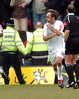 Photo: Leigh Quinnell.<br /> Watford v Luton Town. Coca Cola Championship. 09/04/2006. Lutons Ahmet Brkovic keeps the Watford fans quiet after his goal.