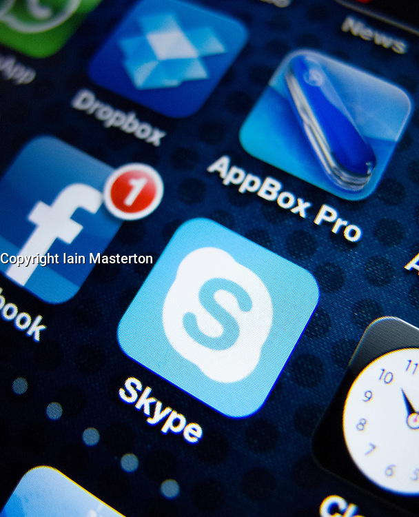 detail of iPhone 4G screen showing Skype online phone app icon