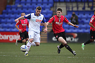 Oldham Athletic's Danny Philliskirk (r) battles with Tranmere Rovers' Steven Jennings. Skybet football league 1match, Tranmere Rovers v Oldham Athletic at Prenton Park in Birkenhead, England on Saturday 1st March 2014.<br /> pic by Chris Stading, Andrew Orchard sports photography.